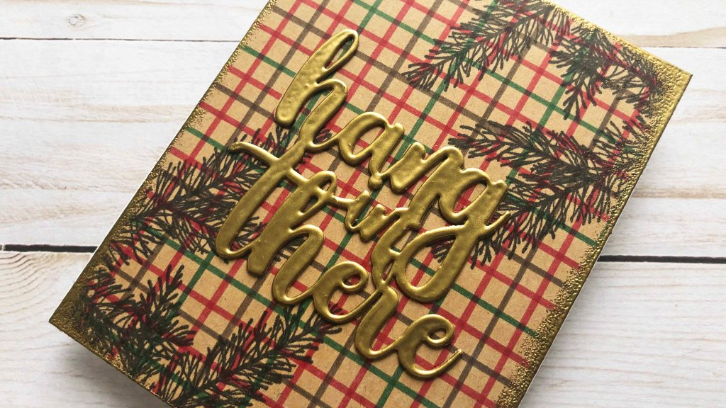 A Christmas themed thinking of you card with Tattersall patterned background.