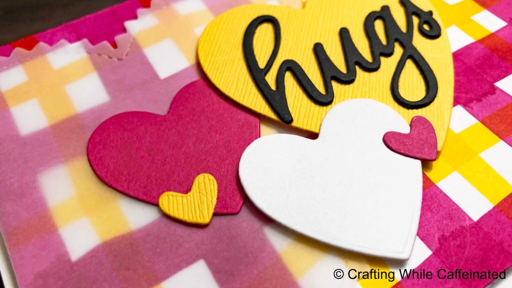 Layering die cuts, in this case hearts, is a fun way to finish your handmade cards!