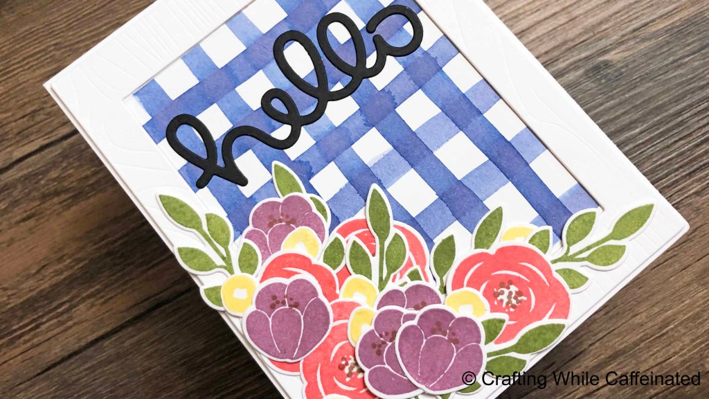 This gingham background made the perfect center background for the Wood Grain Frame die! Adding the cluster of flowers and Hello sentiment finished this card beautifully!
