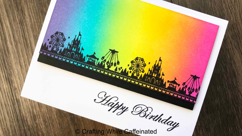The circus silhouette just called for a bright rainbow ink blended background!