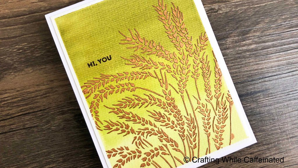 A simple hello card with an ombre watercolor background. I used the new wheat stalk stencil from TCW and antique gold modeling paste over the top.