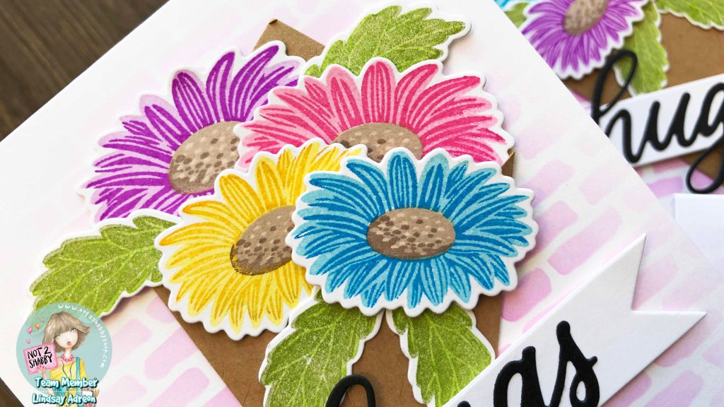 Adding the leaves in different places each time helps fill in holes in the bouquet and make each bouquet a little different from the next on each handmade greeting card.