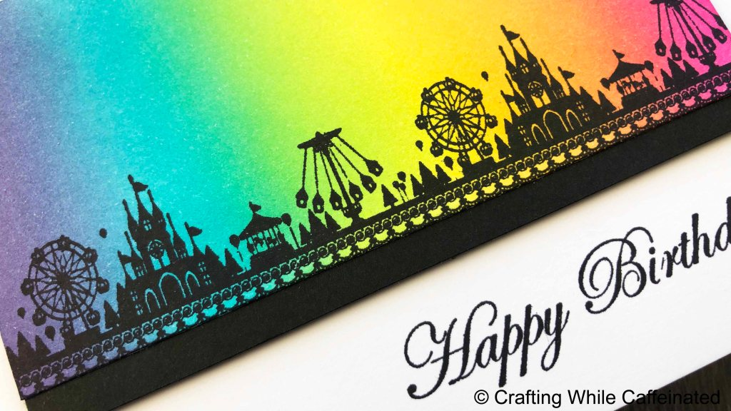 The rainbow background is ink blended with dye inks. Because of that, I used a black pigment ink to stamp the circus border rubber stamp on top, so the colors don't mix.
